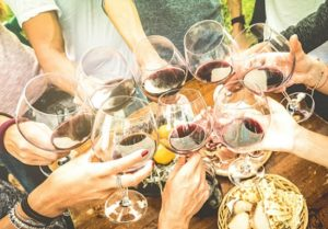 friends-hands-toasting-red-wine-glass-and-having-fun-outdoors-with-picture-id685888824 - Copy - Cell