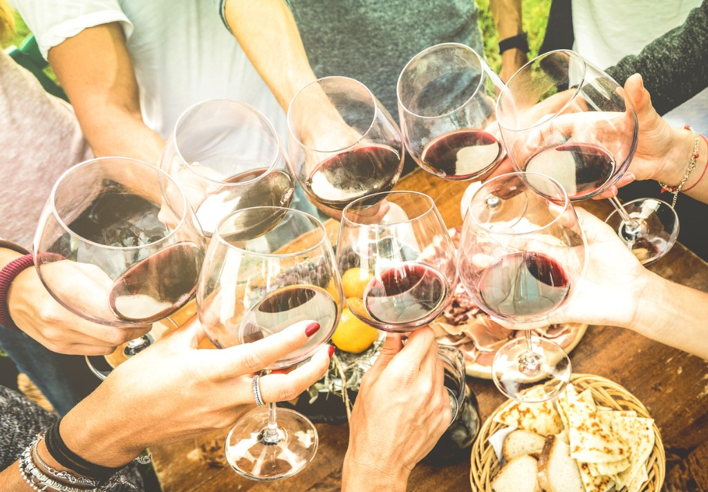 friends-hands-toasting-red-wine-glass-and-having-fun-outdoors-with-picture-id685888824 - Copy