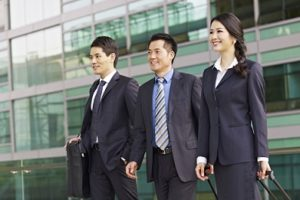 team of asian business people with modern building background.