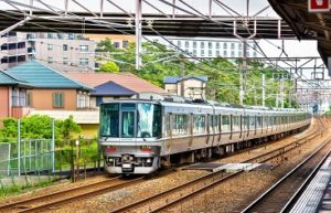 Rapid train is passing Maiko station, Kobe, Japan