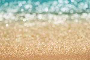 Abstract blur seascape bokeh. Defocused sand beach and sea water in nature, evening summer time
